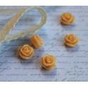 Цветочек пластиковый малый, размер 1.2 см, цвет светло-персиковый, 1шт.